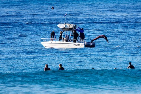 The water taxi dropping off surfers at South Stradbroke Island.
